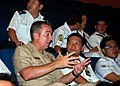 US Navy 090619-N-0869H-017 Chief Warrant Officer Troy Roat, assigned to Mobile Diving and Salvage Unit (MDSU) 1, Company 14, speaks with a Republic of Singapore Navy officer.jpg