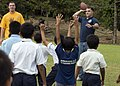 US Navy 090624-N-1722M-460 Cpl. Joshua Coldiron, assigned to the 24th Marine Regiment, throws a pass during a game of American football with Malaysian students.jpg