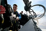 US Navy 091006-N-9001B-068 NASA astronaut candidate Dr. Kjell Lindgren and Lt. Cmdr. Paul Easterling, a flight instructor with Training Air Wing (TRAWING) 6, conduct a preflight check of the cockpit of a T-6A Texan II.jpg