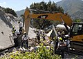 US Navy 100122-N-6639M-040 Members of the Fairfax County Search and Rescue team continue to dig through the rubble of what used to be the Hotel Montana in Port-au-Prince.jpg