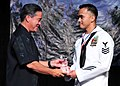 US Navy 100410-N-3620L-059 Gov. Felix Camacho, left, presents Hospital Corpsman 1st Class Samuel Ramos Jr. the Guam USO 2009 Navy Volunteer of the Year award.jpg