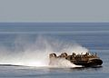 US Navy 100521-N-1082Z-021 Landing Craft Air Cushion (LCAC) 77, assigned to Assault Craft Unit (ACU) 4, transports personnel and equipment to the amphibious dock landing ship USS Ashland (LSD 48).jpg