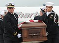 US Navy 100927-N-4420S-206 Navy SEALs carry the casket of Special Warfare Operator (SEAL) 3rd Class Denis Miranda off the flight line of Joint Base.jpg