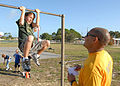 US Navy 101130-N-5523J-005 Electricians Mate 1st Class Claude Troullier coaches a student from the fourth grade class at San Pablo Elementary School.jpg