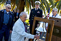 US Navy 101207-N-8863V-497 Roger Marron, 90, center, rings a bell at Naval Surface Warfare Center, Corona Division during a ceremony commemorating.jpg