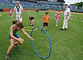 US Navy 110614-N-SH953-505 Sailors assigned to USS Constitution watch a child run through a hula hoop at the YMCA fitness challenge during Chattano.jpg