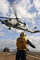 US Navy 111129-N-YM590-059 Boatswain's Mate Seaman Apprentice Jabari Hosten directs an SH-60B Sea Hawk helicopter, assigned to Helicopter Maritime.jpg