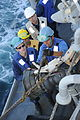 US Navy 111210-N-NP071-021 Sailors prepare for a refueling at sea.jpg