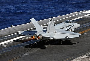 US Navy 111224-N-YB753-024 Jet lands on the flight deck.jpg