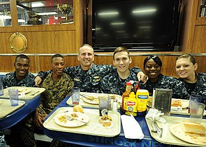 US Navy 120204-N-WL435-150 Chief of Naval Operations (CNO) Adm. Jonathan Greenert has lunch with the crew aboard the amphibious assault ship USS Wa.jpg