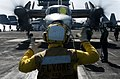 US Navy 120206-N-OY799-341 A Sailor directs a jet.jpg