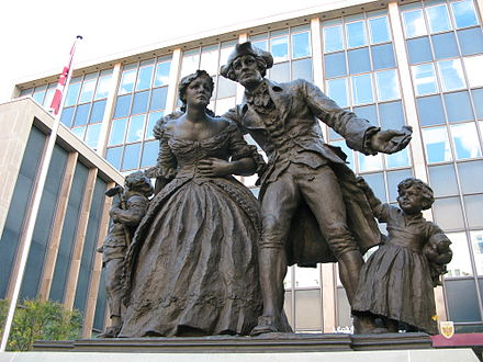 A monument in Hamilton commemorating the United Empire Loyalists, a group of settlers who fled the United States during or after the American Revolution United Empire Loyalist Statue in Hamilton, Ontario.jpg