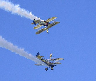 Wing walking - The UK Utterly Butterly display team perform wing walking with their Boeing Stearmans in 2006.
