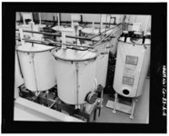 VIEW OF ROOM 103 IN 1980. SIX OF THE NINE URANIUM NITRATE STORAGE TANKS ARE SHOWN. HIGHLY ENRICHED URANIUM WAS INTRODUCED INTO THE BUILDING IN THE SUMMER OF 1965 AND THE FIRST HAER COLO,30-GOLD.V,1A-4.tif