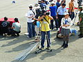 Video Camera Reporter Chen Photoing People on Stairs and Stand 20131013.jpg