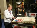 Virginia M. Blaser cuts the 235th Independence Anniversary Cake.jpg