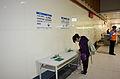 Visitor Stamping Memorial Stamp in Nanjing Sanmin Station at Taipei Metro Songshan Line First Day 20141115.jpg
