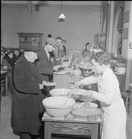 A British Restaurant in London, 1942. 2000 were opened to serve low-cost basic meals. WOOLMORE STREET BRITISH RESTAURANT 1942.jpg