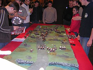 Wargaming - Warhammer Fantasy Battle in progress.  Painted miniatures represent the troops, and dice are used to determine the results of actions taken.