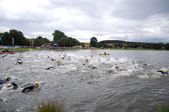 Open water swimming - Triathletes competing in open water swimming