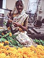 Woman stringing flowers for Diwali, Mumbai.jpg