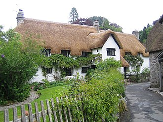 "Chocolate box art - Wrayland Manor. The archetypal chocolate box Devon thatched house in the hamlet of Wrayland. Several old chocolate boxes and postcards depict this particular building, calling it variously the Hall House and an ""Old Cottage""."