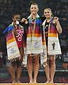 XIX Commonwealth Games-2010 Delhi Winners of Women's Gymnastics Vault progress, Cairns Imogen of England (Gold), May Gabby of Canada (Silver) and Kristin Jana Klarenbach of Canada (Bronze).jpg