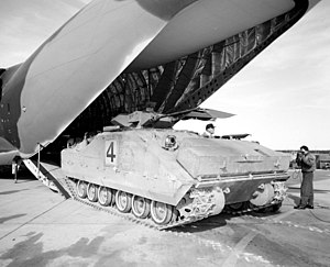 Bradley Fighting Vehicle - XM723 prototype being offloaded from a McDonnell Douglas YC-15 during a test, 1977