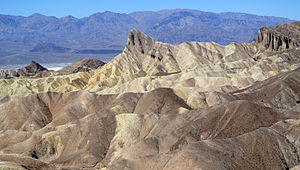 Zabriskie Point - View of Manly Beacon from Zabriskie Point, showing convolutions, texture, and color contrasts in the eroded rock
