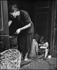 """Children In Naples, Italy"". Children playing while mother works. Photographed by Lieutenant Wayne Miller, July 1944. U.S. Navy Photograph, now in the collections of the National Archives.jpg"