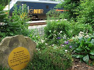 An InterCity 225 passing the memorial garden created next to the East Coast Main Line for the four people who died in the Hatfield rail crash