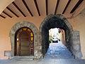 104 Plaça del Bo-bo (Monistrol de Montserrat), porxo i entrada al c. Sant Joan.JPG