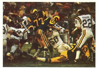 History of the Minnesota Vikings - The Vikings' famed Purple People Eaters defensive line stopping a Rams rush in the 1977 NFC Divisional Playoff game.