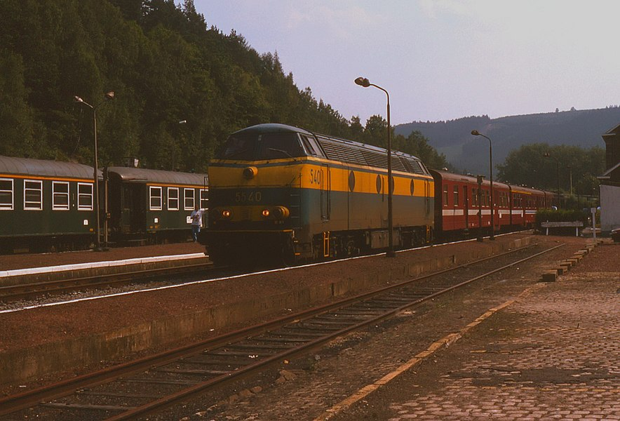 Belgian Railways class 55 no. 5540 on one of its common workings - InterRegional trains on the Liège to Luxembourg line prior to electrification. Seen at Trois Ponts in Belgium on 19 August 1995 is 5540 on train IR116, 14:10 Luxembourg to Liège-Guillemins.