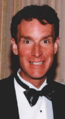 1999 Bill Nye receives Public Service Award from National Science Board (cropped to Nye collar).png