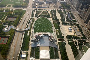 Jay Pritzker Pavilion - The Great Lawn, trellis and pavilion with the adjoining Harris Theater, within Millennium Park