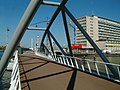 2005.04 - 'View over the metallic bowed bridge' - Amsterdam photos, a picture of the new bridge for pedestrians and cyclists, near Nemo museum in the Oosterdokr; Dutch city + geotag, Fons Heijnsbroek, The Netherlands (27567830835).jpg