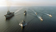 Six late-Twentieth century Royal Navy ships steaming in formation at sea