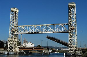 Fruitvale Bridge - Partially raised bascule on road bridge, immediately behind rail bridge.