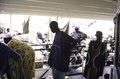 ASC Leiden - van Achterberg Collection - 03 - 73 - Sur le pont du ferry de Ségou à Mopti à l'ombre. Un homme dans une veste violette - Ségou, Mali - novembre-décembre 1993.tif