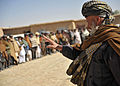 A Nawbahar district official speaks to village elders during a shura, or meeting, at the Afghan National Police compound in the district in Zabul province, Afghanistan, March 7, 2012 120307-N-UD522-119.jpg