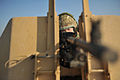 A Soldier Aims his Warthog Vehicle Mounted General Purpose Machine Gun MOD 45153576.jpg