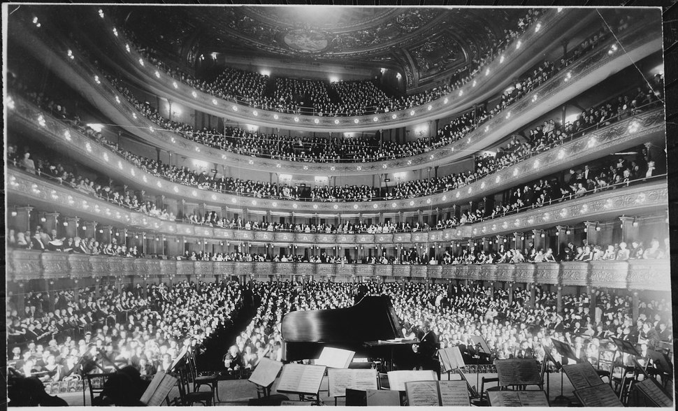 A full house, seen from the rear of the stage, at the Metropolitan Opera House for a concert by pianist Josef Hofmann, 1 - NARA - 541890