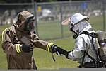 A member of the Marine Corps Air Station Beaufort fire department is helped out of his HAZMAT suit as he goes through a decontamination center at the sight chemical spill at the training pool at Marine Corps Air 130719-M-VR358-110.jpg