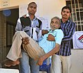 A physically challenged being escorted after casting his vote, at a polling booth, during the 8th Phase of General Elections-2014, at Madhavadhara, in Visakhapatnam, Andhra Pradesh on May 07, 2014.jpg