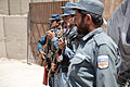 Afghan Uniform Police officers stand in formation as provincial government officials pass by after a clinic opening ceremony in Mya Neshin district, Kandahar province, Afghanistan, June 1, 2013 130601-A-IS772-168.jpg
