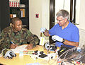 Alan V. Wackowski of the PMAT team and Airman 1st Class Leotis Ott a Supply Management Apprentice work together during a base wide inspection done to perform function checks on all chemical warfare masks on 020717-F-RX586-001.jpg