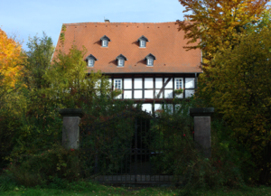 Today's half-timbered house with entrance via a moat