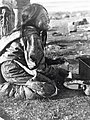 Alunaq collecting fish oil (38614).jpg