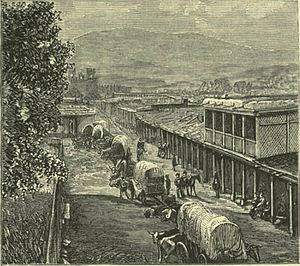 Gillum Baley - 19th-century depiction of wagon trains entering Santa Fe, New Mexico